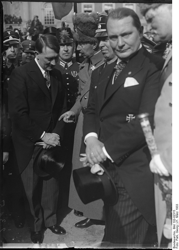 Adolf Hitler with Crown Prince Wilhelm, Hermann Göring stands to the side looking at the camera