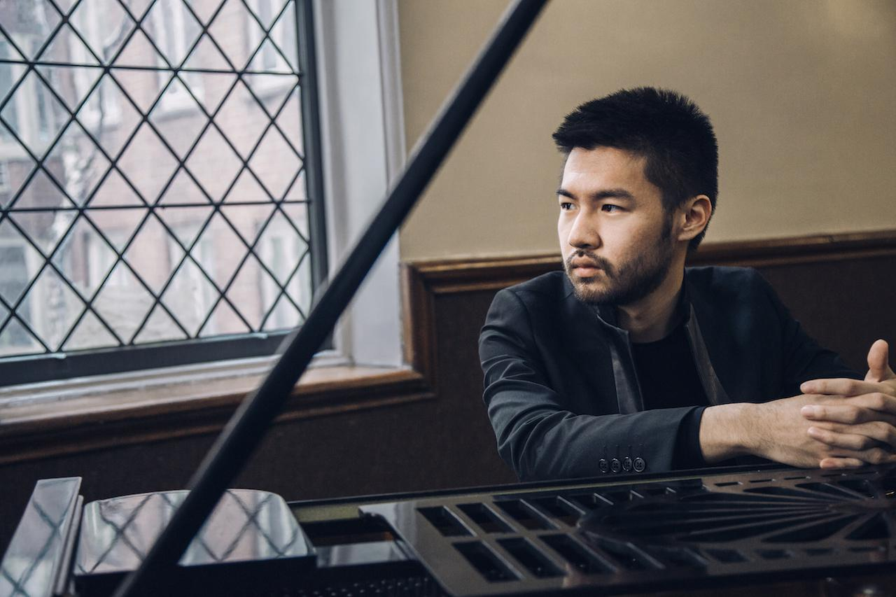 Promotional image of Conrad Tao at the piano