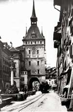 the old clock tower and an electrified trolley in Bern
