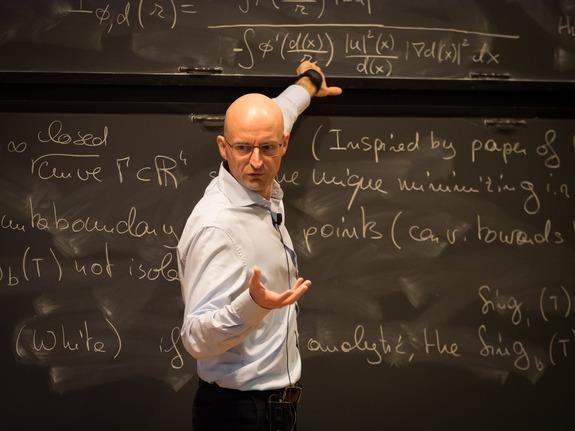Camillo De Lellis speaks at the blackboard