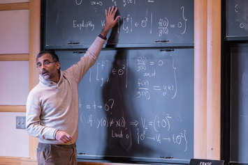 Akshay Venkatesh answers a question at the blackboard
