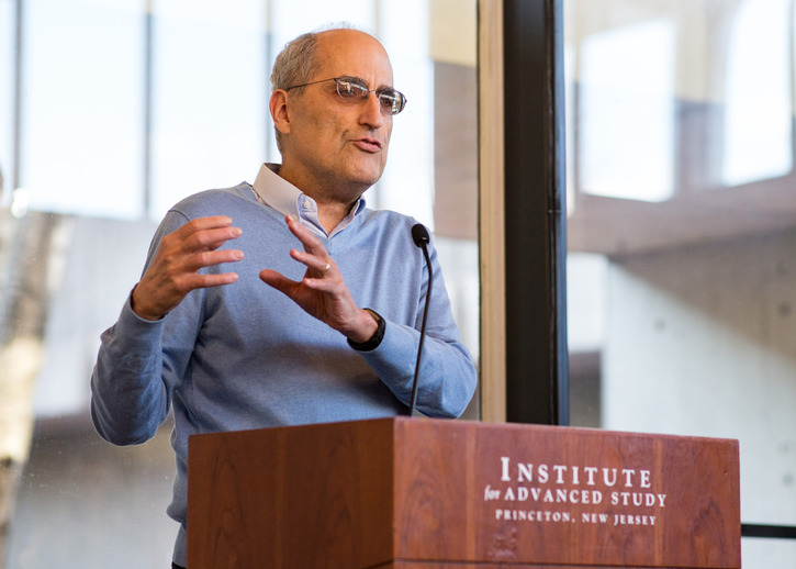Edward Witten speaks at the podium in Simons Hall at the Institute for Advanced Study
