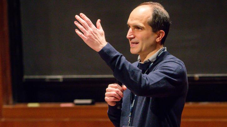 Juan Maldacena speaks on stage in Wolfensohn Hall
