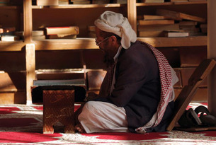 A Yemeni man reads the Qur'an at the Great Mosque in the old city of the capital Sana'a.