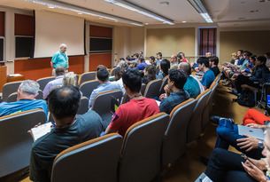 Arnold Levine gives a lecture in Bloomberg Hall