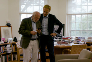 Jim Simons stands reading with Robbert Dijkgraaf