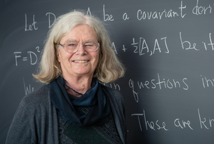 Karen Uhlenbeck poses for a headshot at the blackboard