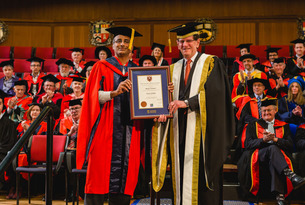 Akshay Venkatesh accepts an honorary doctorate during a ceremony at the University of Western Australia