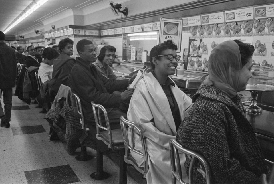 On February 13, 1960, students line the counter of a dime store in Greensboro, North Carolina, in protest of the store's refusal to serve them.