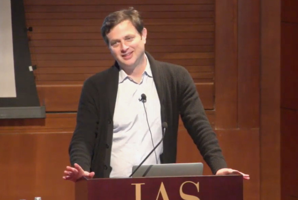 Benjamin Greenbaum talks at the podium in Wolfensohn Hall at the Institute for Advanced Study
