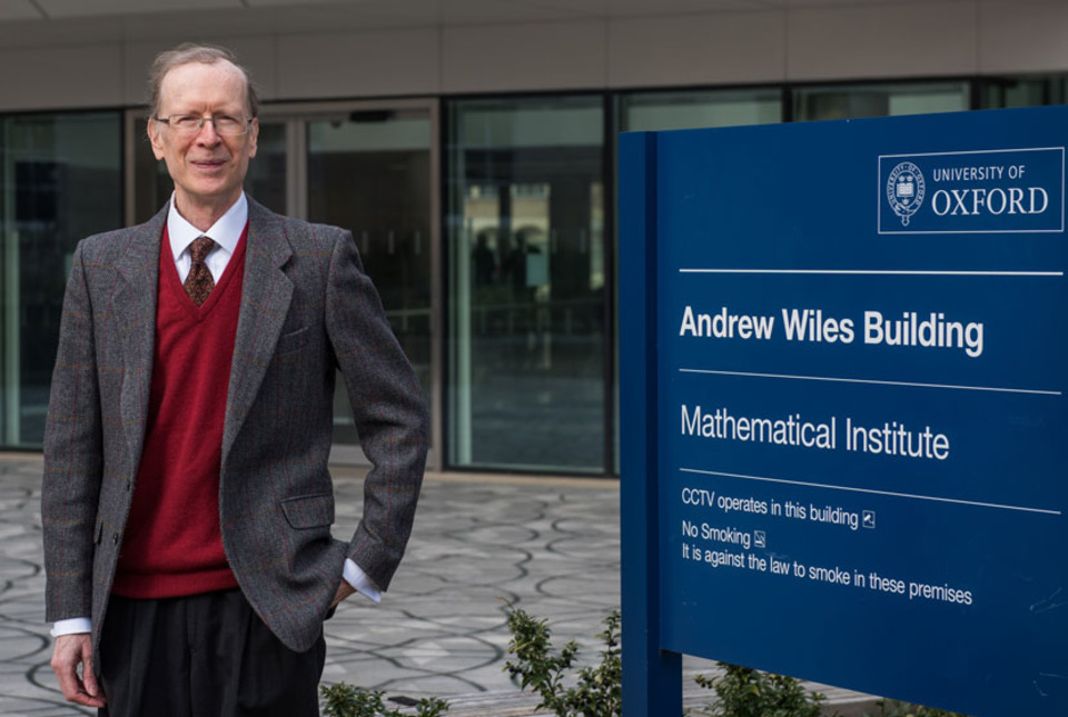 Andrew Wiles outside the Institute of Mathematics at Oxford University, named in his honor.